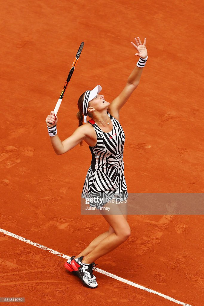 Kristina Mladenovic of France serves during the Ladies Singles third round match against Serena Williams of the United States on day seven of the 2016 French Open at Roland Garros on May 28, 2016 in Paris, France.