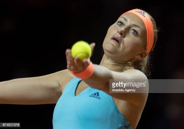 Kristina Mladenovic of France serves the ball to Angelique Kerber of Germany during the Porsche Tennis Grand Prix at Porsche Arena in Stuttgart...