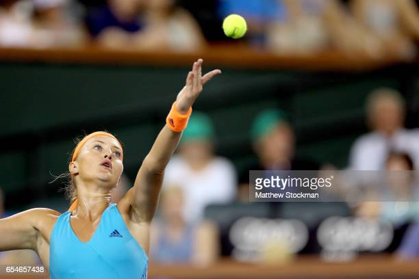 Kristina Mladenovic of France serves to Elena Vesnina of Russia during the semifinals of the BNP Paribas Open at the Indian Wells Tennis Garden on...