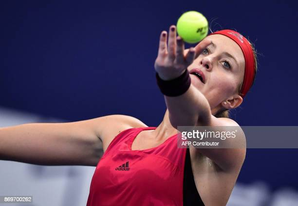 Kristina Mladenovic of France serves to Julia Goerges of Germany during their women's singles match at the Zhuhai Elite Trophy tennis tournament in...