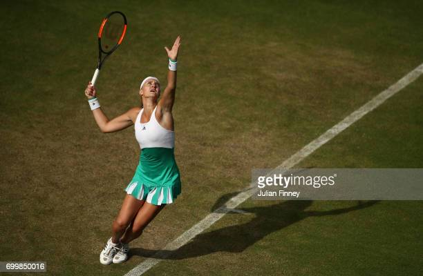 Kristina Mladenovic of France serves to Shuai Zhang of China during day four of the Aegon Classic at Edgbaston Priory Club on June 22 2017 in...