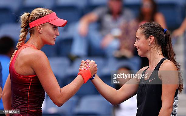 Kristina Mladenovic of France shakes hands with Daria Kasatkina of Russia after defeating her during their Women's Singles Third Round match on Day...