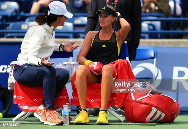 Kristina Mladenovic of France speaks to a team member during her match against Barbora Strycova of Czech Republic during Day 3 of the Rogers Cup at...