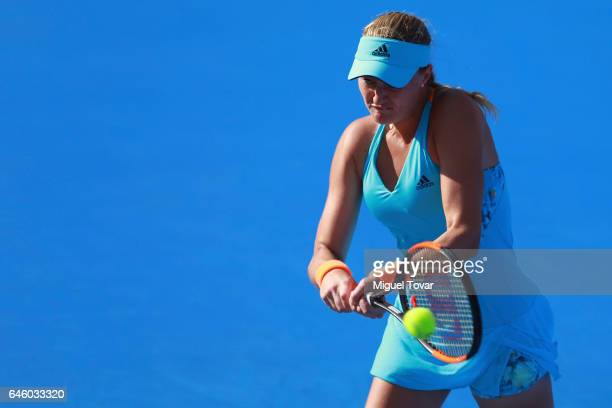Kristina Mladenovic of France takes a backhand shot during a first round match between Kristina Mladenovic of France and Varvara Lepchenko of USA as...