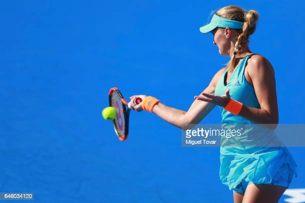 Kristina Mladenovic of France takes a forehand shot during a first round match between Kristina Mladenovic of France and Varvara Lepchenko of USA as...