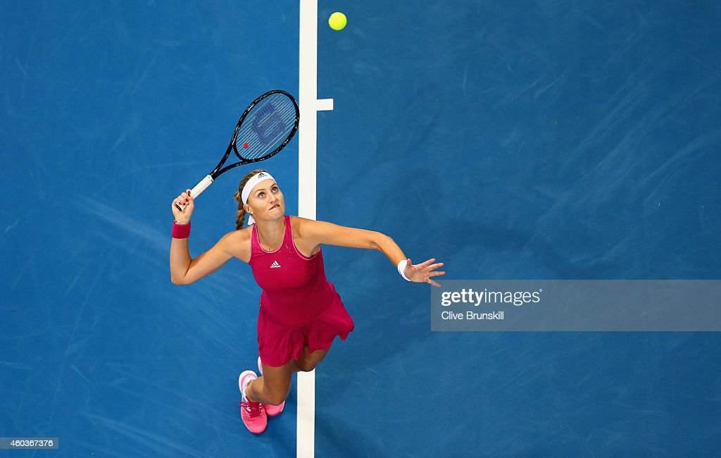 Kristina Mladenovic of the UAE Royals serves against Daniela Hantuchova of the Singapore Slammers during the Coca-Cola International Premier Tennis League fourth leg at the Hamdan Sports Complex, December 12, 2014 in Dubai, .