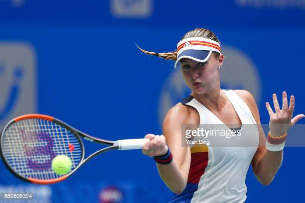 Kristina Mladenovic plays a forehand during the match against Katerina Siniakova on Day 1 of 2017 Dongfeng Motor Wuhan Open at Optics Valley...
