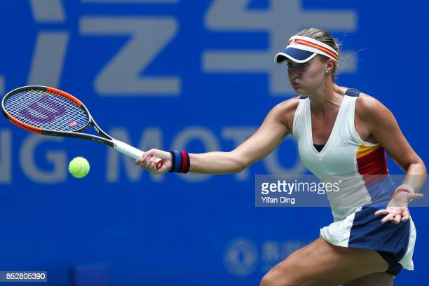 Kristina Mladenovic serves during the match against Katerina Siniakova on Day 1 of 2017 Dongfeng Motor Wuhan Open at Optics Valley International...