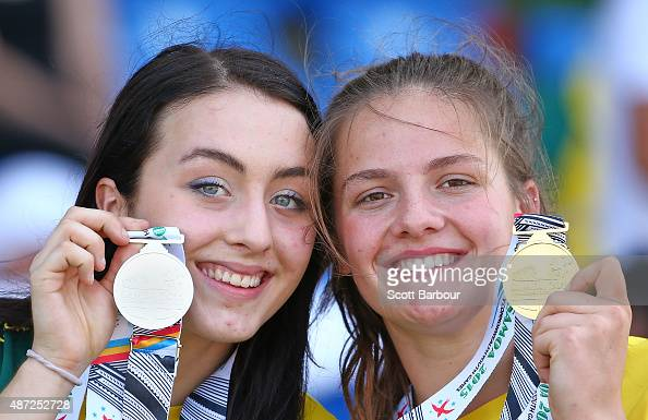 Kristina Moore and Bianca Hansen of Australia pose with their gold and silver medals after the Girls Discus medal presentation during the Athletics...