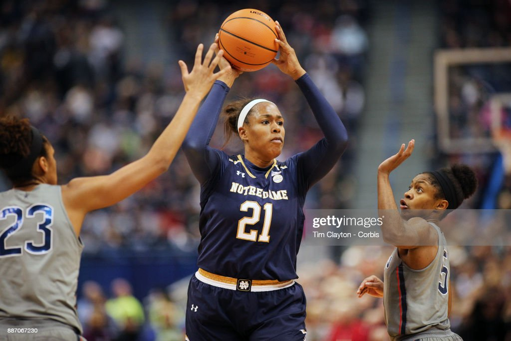 Kristina Nelson #21 of the Notre Dame Fighting Irish defended by Azura Stevens #23 of the Connecticut Huskies and Crystal Dangerfield #5 of the Connecticut Huskies during the the UConn Huskies Vs Notre Dame, NCAA Women's Basketball game at the XL Center, Hartford, Connecticut. December 3, 2017