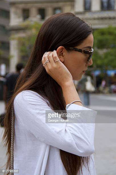 Kristina Petrick wearing white linen Sauths dress with three quarter length sleeves Wyeth brown oversized sunglasses YSL black leather quilted bag...