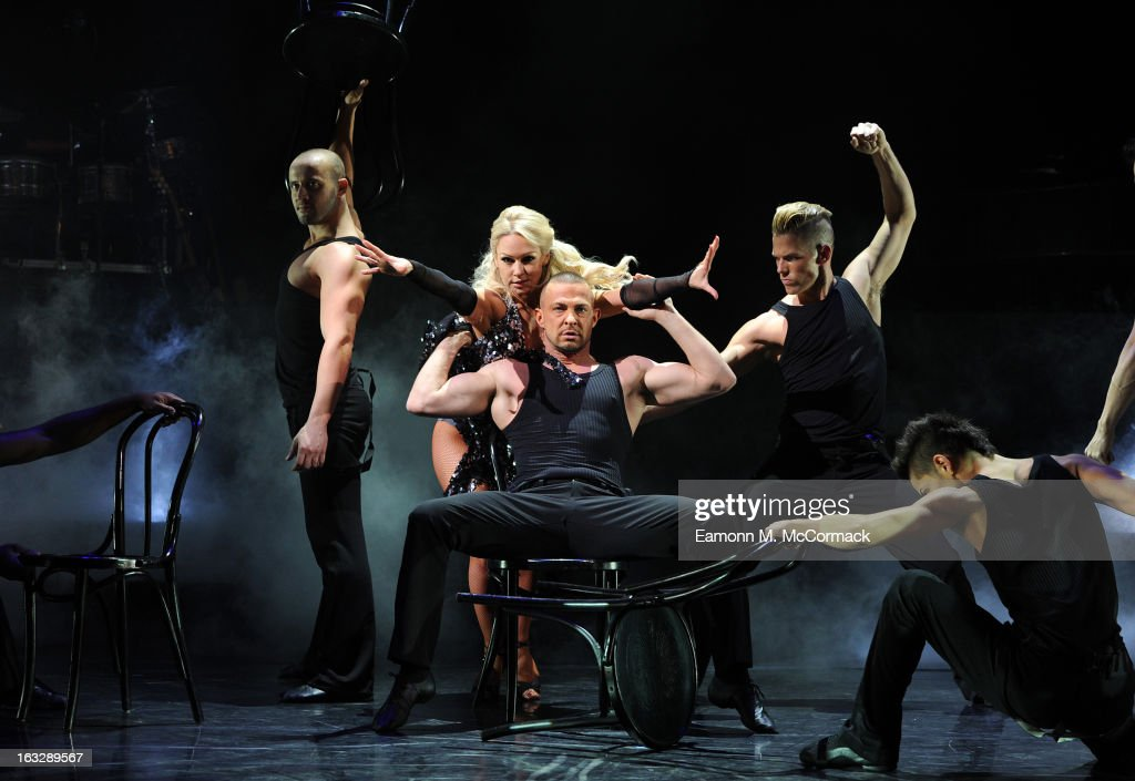 Kristina Rihanoff and Robin Windsor perform during a photocall for 'Burn The Floor' at Shaftesbury Theatre on March 7, 2013 in London, England.