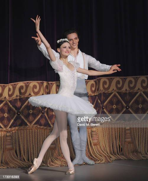 Kristina Shapran and Sergei Polunin on stage the press night performance of Roland Petit's 'Coppelia' at the London Coliseum on July 11 2013 in...