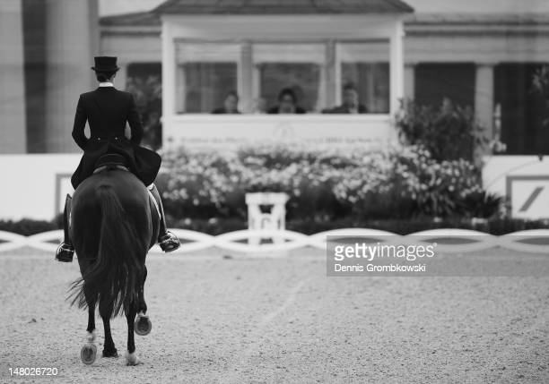 Kristina Spehe of Germany and her horse Desperados 11 compete in the Deutsche Bank Price freestyle dressage grand prix during day six of the 2012...