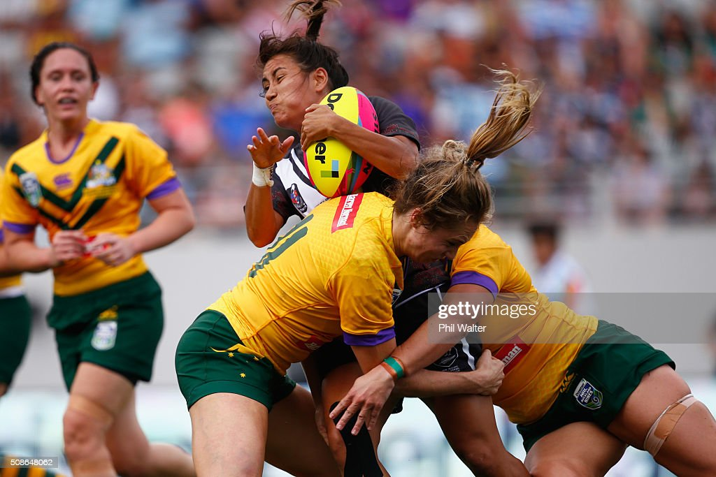 Kristina Sue of the New Zealand Ferns is tackled during the 2016 Auckland Nines match between the Australian Jillaroos and the New Zealand Ferns at Eden Park on February 6, 2016 in Auckland, New Zealand.