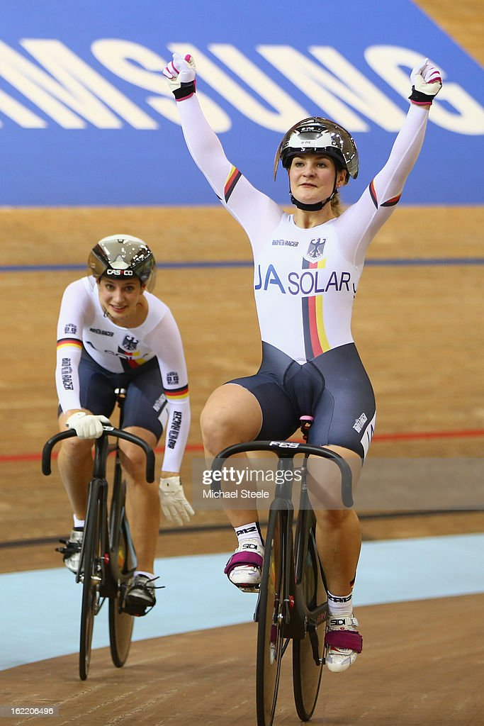 Kristina Vogel (R) and Miriam Welte (L) of Germany celebrate winning gold in the women's team sprint during day one of the UCI Track World Championships at Minsk Arena on February 20, 2013 in Minsk, Belarus.