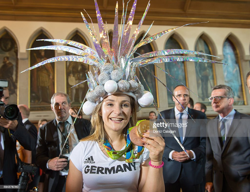 Kristina Vogel poses with her gold and bronze medal on August 23 2016 in Frankfurt am MaIN GERMANY