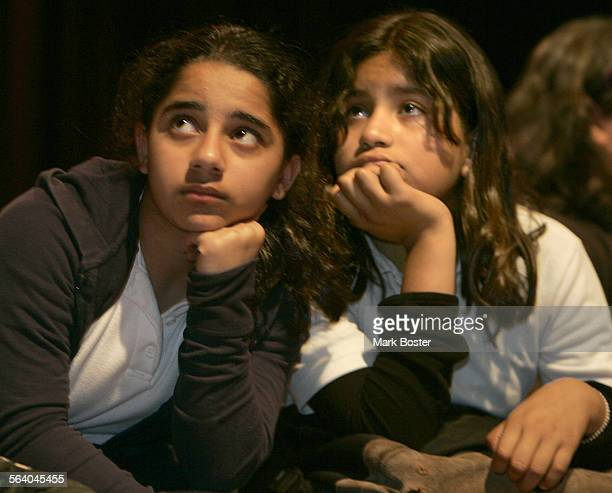 – Kristine Antonyan and Anamaria Saravia listen to fellow students reciting poetry at Thomas Starr King Middle School in Silver Lake during the...