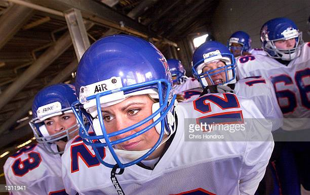 Kristine Fitzpatrick center and other members of the women''s professional football team the New York Gems line up before an exhibition game against...