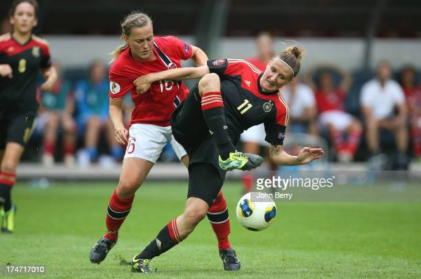 Kristine Hegland of Norway and Anja Mittag of Germany in action during the UEFA Women's Euro 2013 Final between Germany and Norway at the Friends...