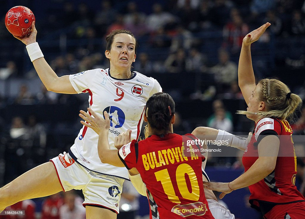 Kristine Lunde-Borgersen (L) of Norway in action against Andjela Bulatovic of Montenegro (C) during the Women's European Handball Championship 2012 gold medal match between Norway and Montenegro at Arena Hall on December 16, 2012 in Belgrade, Serbia.