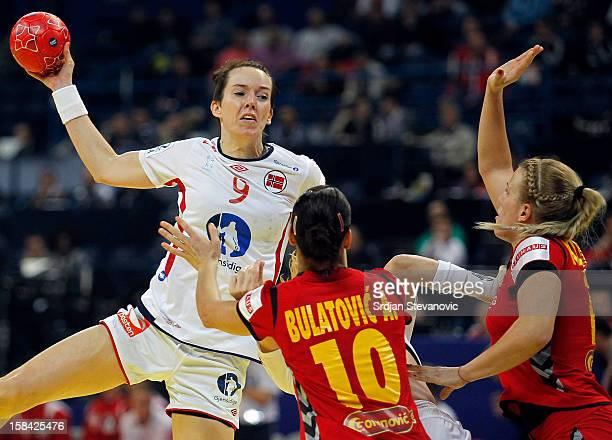 Kristine LundeBorgersen of Norway in action against Andjela Bulatovic of Montenegro during the Women's European Handball Championship 2012 gold medal...