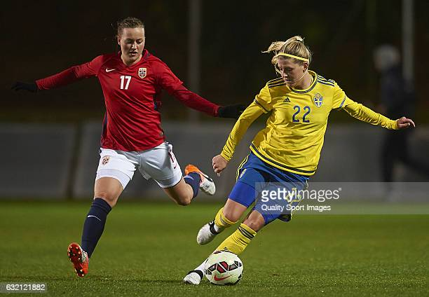 Kristine Minde of Norway competes for the ball with Olivia Schough of Sweden during the international friendly match between Norway Women and Sweden...