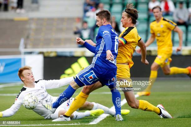 Kristinn Freyr Sigurdsson of GIF Sundsvall and Isak Pettersson goalkeeper of Halmstad BK during the Allsvenskan match between GIF Sundsvall and...