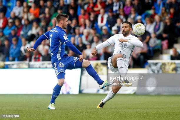 Kristinn Freyr Sigurdsson of GIF Sundsvall and Saman Ghoddos of Ostersunds FK during the Allsvenskan match between GIF Sundsvall and Ostersunds FK at...