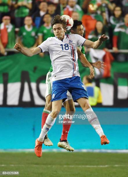 Kristjan Floki Finnbogason of Iceland and Jesus Molina of Mexico attempt to head the ball during their exhibition match at Sam Boyd Stadium on...