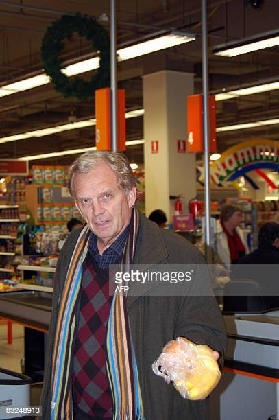 Kristjan FOddsson an Icelandic bookkeeper holds a bag with two bananas and an orange he will have for breakfast as he leaves the Kringlan largest...