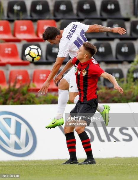 Kristof Herjeczki of Budapest Honved battles for the ball in the air with Branko Pauljevic of Ujpest FC during the Hungarian OTP Bank Liga match...