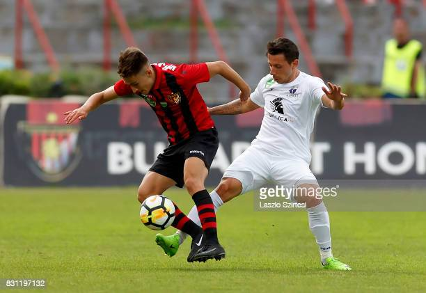 Kristof Herjeczki of Budapest Honved duels for the ball with Branko Pauljevic of Ujpest FC during the Hungarian OTP Bank Liga match between Budapest...