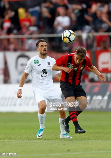 Kristof Herjeczki of Budapest Honved heads the ball in front of David Mohl of Ujpest FC during the Hungarian OTP Bank Liga match between Budapest...