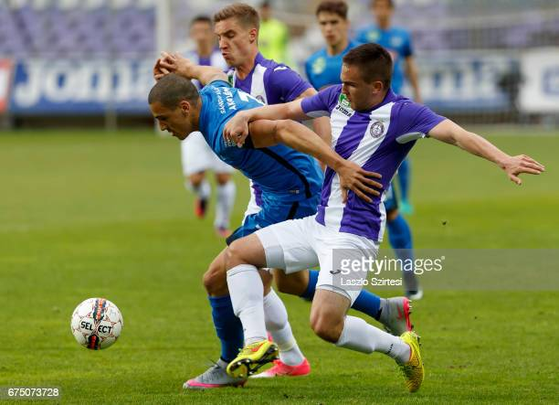 Kristof Szucs of Ujpest FC and Balazs Balogh of Ujpest FC battle for the ball with Myke Bouard Ramos of MTK Budapest during the Hungarian OTP Bank...