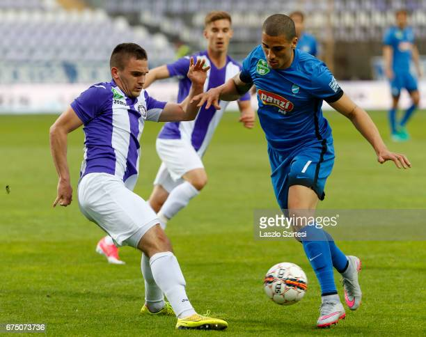 Kristof Szucs of Ujpest FC challenges Myke Bouard Ramos of MTK Budapest during the Hungarian OTP Bank Liga match between Ujpest FC and MTK Budapest...