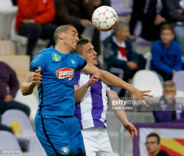 Kristof Szucs of Ujpest FC competes for the ball in the air with Myke Bouard Ramos of MTK Budapest during the Hungarian OTP Bank Liga match between...