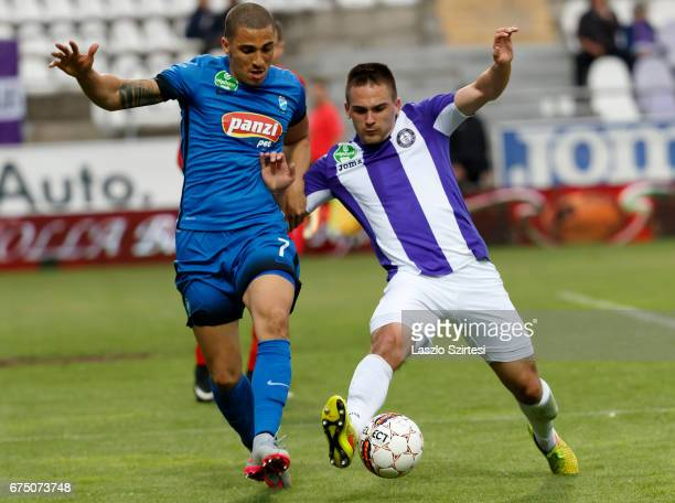 Kristof Szucs of Ujpest FC competes for the ball with Myke Bouard Ramos of MTK Budapest during the Hungarian OTP Bank Liga match between Ujpest FC...