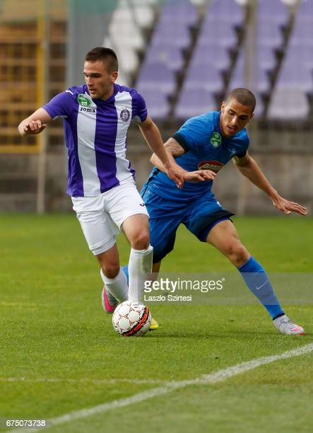 Kristof Szucs of Ujpest FC wins the ball from Myke Bouard Ramos of MTK Budapest during the Hungarian OTP Bank Liga match between Ujpest FC and MTK...