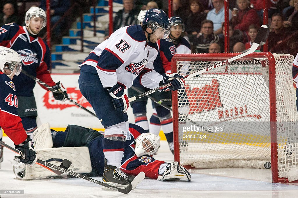 Kristoff Kontos #17 of the Saginaw Spirit drives the puck past Alex Fotinos #39 of the Windsor Spitfires on March 6, 2014 at the WFCU Centre in Windsor, Ontario, Canada.