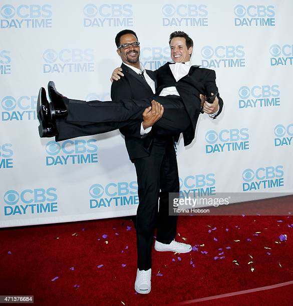 Kristoff St John lifts Christian LeBlanc at the CBS Daytime Emmy after party at Hollywood Athletic Club on April 26 2015 in Hollywood California