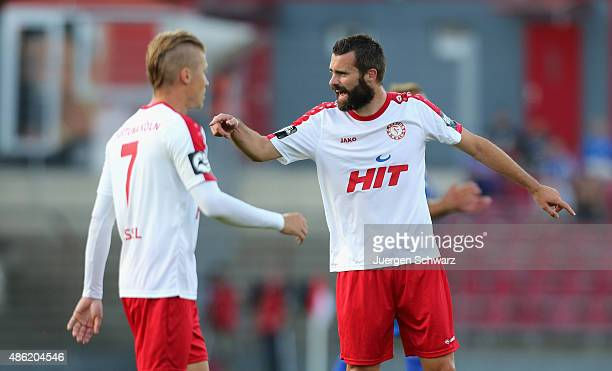 Kristoffer Andersen of Cologne gives instructions near Michael Kessel during the third Bundesliga match between Fortuna Koeln and 1 FC Magdeburg on...