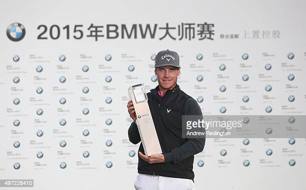 Kristoffer Broberg of Sweden poses with the trophy after winning the BMW Masters at Lake Malaren Golf Club on November 15 2015 in Shanghai China