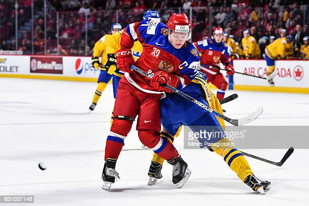 Kristoffer Gunnarsson of Team Sweden delivers a hip check to Kirill Kaprizov of Team Russia during the 2017 IIHF World Junior Championship bronze...