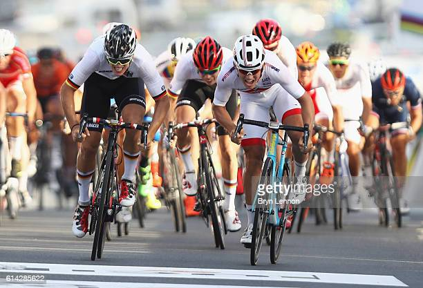 Kristoffer Halvorsen of Norway and Pascal Ackermann of Germany race to the finish line during the Men's Under 23 Road Race on Day Five of the UCI...