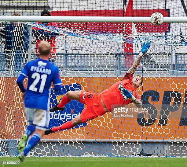 Kristoffer Larsen scores the 10 goal against of Lyngby Boldklub Goalkeeper Johan Dahlin during of FC Midtjylland the Danish Alka Superliga match...