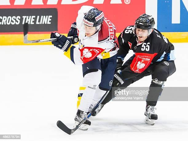 Kristoffer Mohr of Vojens challenges a Jonkoping player during the Champions Hockey League group stage game between SonderjyskE Vojens and HV71...