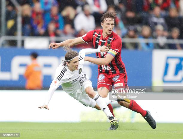 Kristoffer Olsson of AIK and Bobo Sollander of Oestersunds FK competes for the ball during the Allsvenskan match between Ostersunds FK and AIK at...