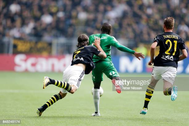 Kristoffer Olsson of AIK and Pa Amat Dibba of Hammarby IF competes for the ball during the Allsvenskan match between Hammarby IF and AIK at Tele2...