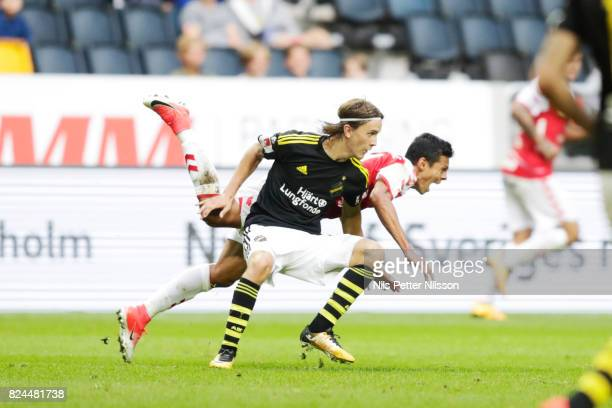 Kristoffer Olsson of AIK and Romario Pereira Sipiao of Kalmar FF during the Allsvenskan match between AIK and Kalmar FF at Friends arena on July 30...